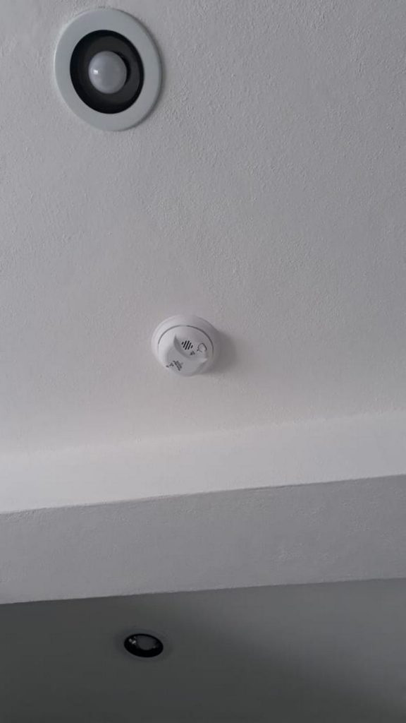 Smoke/carbon monoxide alarms in each apartment